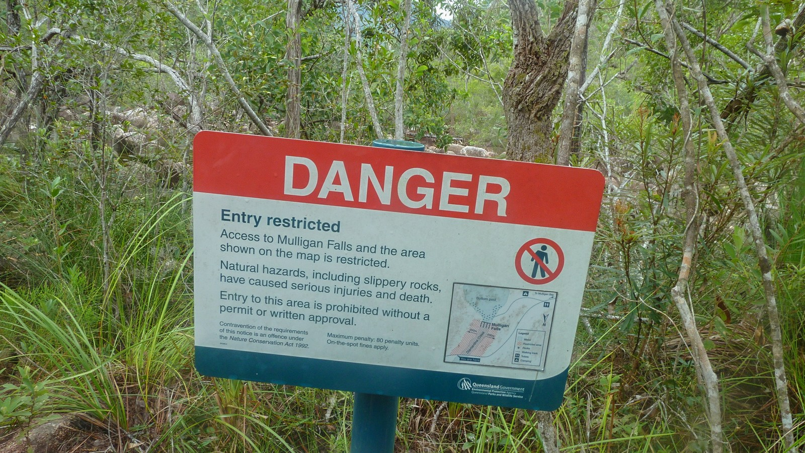 a photo of a warning sign on hinchinbrook island.