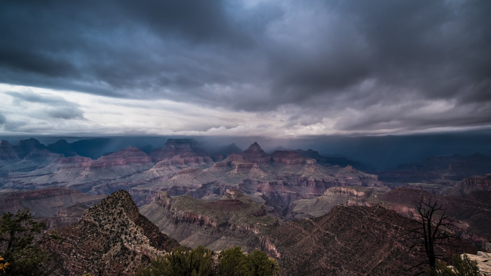 a image by sabbalot photography of a winter storm approaching the grand canyon.