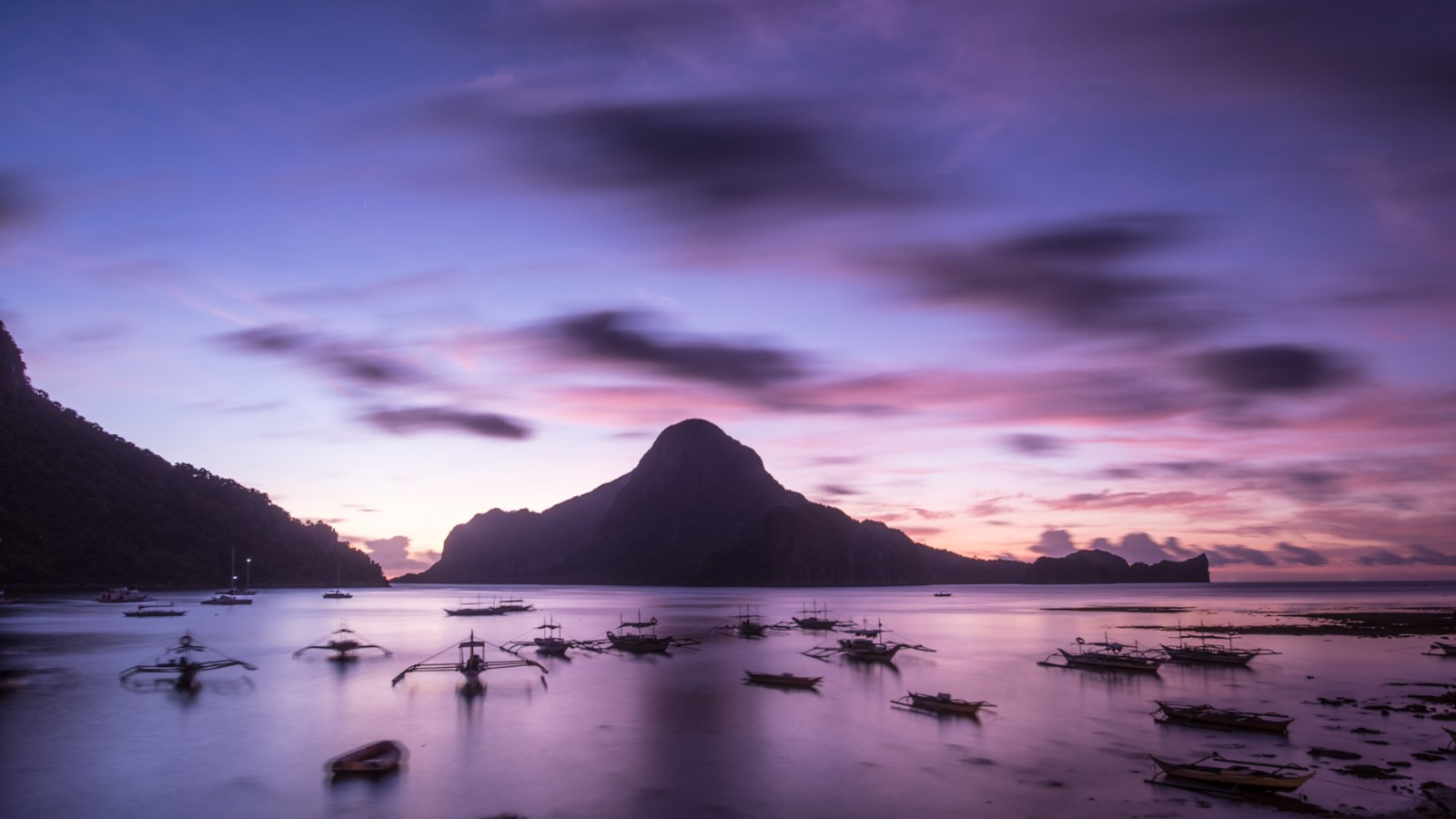 a long exposure shot by sabbalot photography of a sunset at a beach in palawan