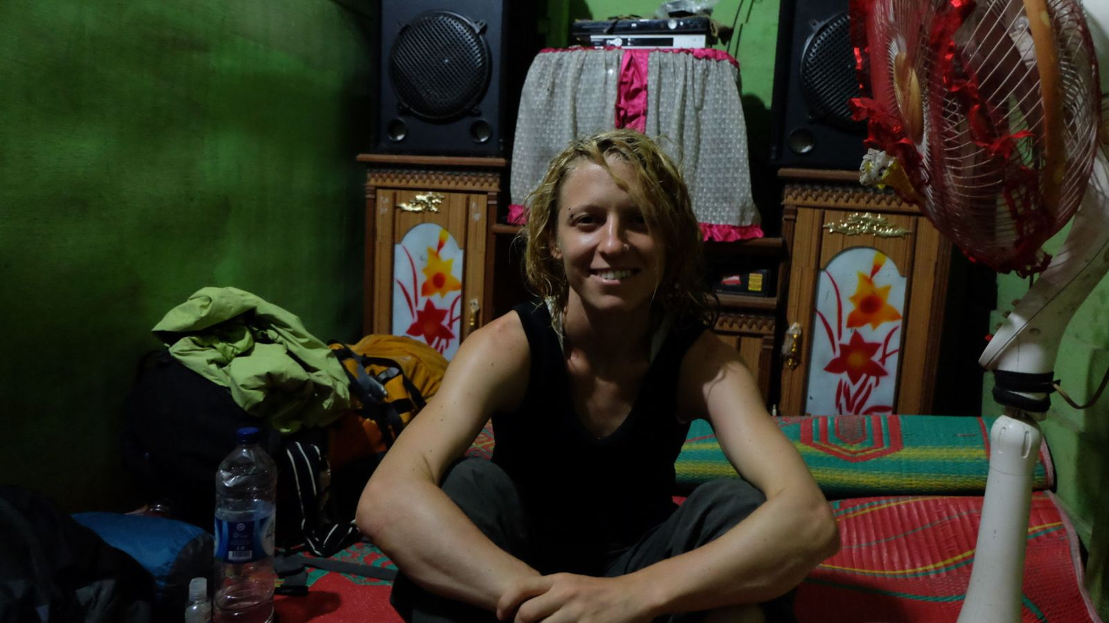 a photo of a hiker in a house in kutacane, sumatra.