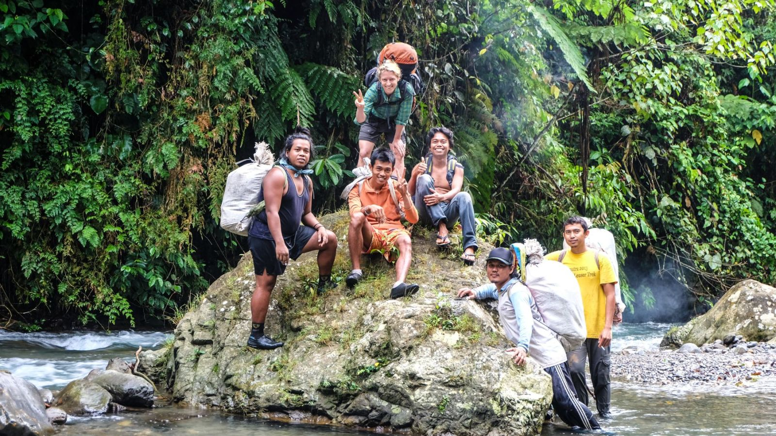 a photo of hikers in gunung leuser national park.