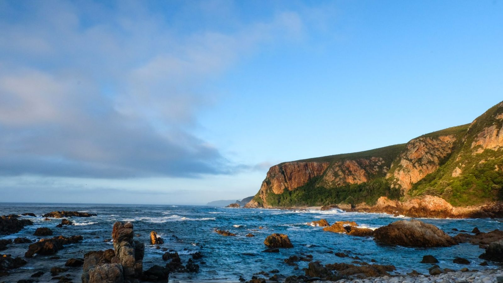 a photo of the coast on the otter trail during sunrise.