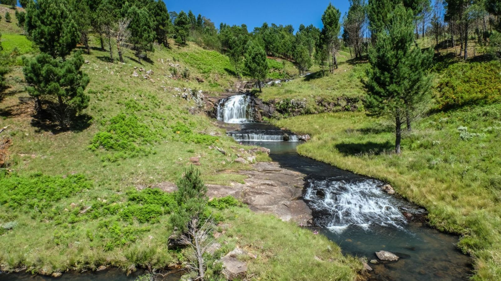 a photo of a cascade of waterfalls on the amathole trail.