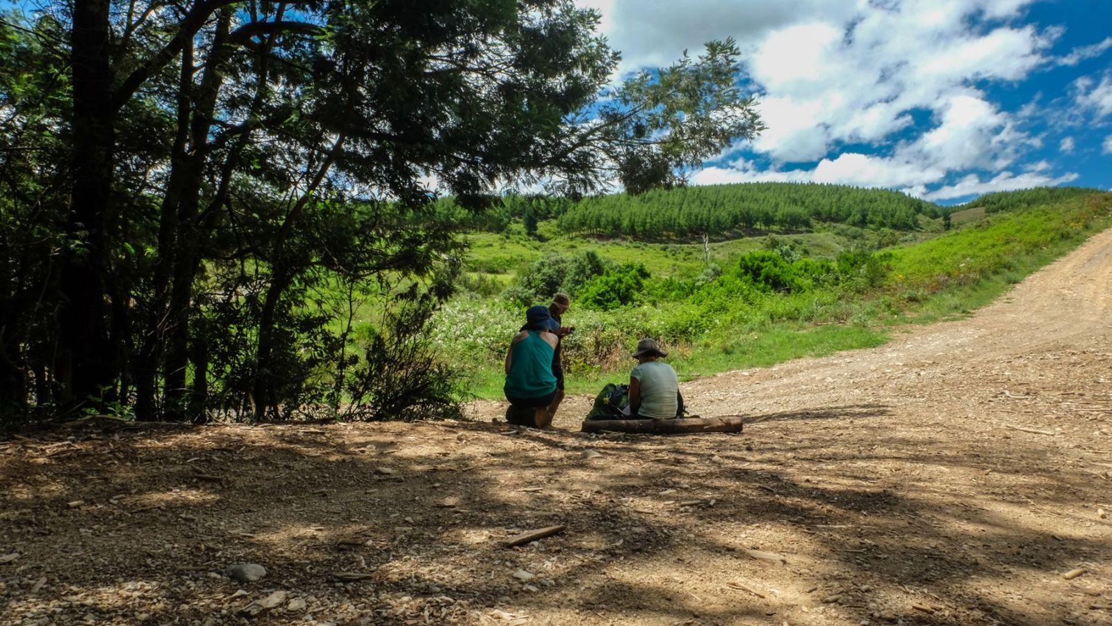 a photo of hikers resting on the amathole hiking trail.