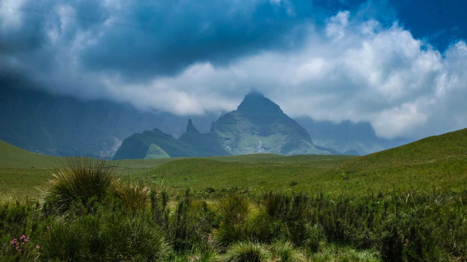 photo of the drakensberg mountains partially covered in clouds
