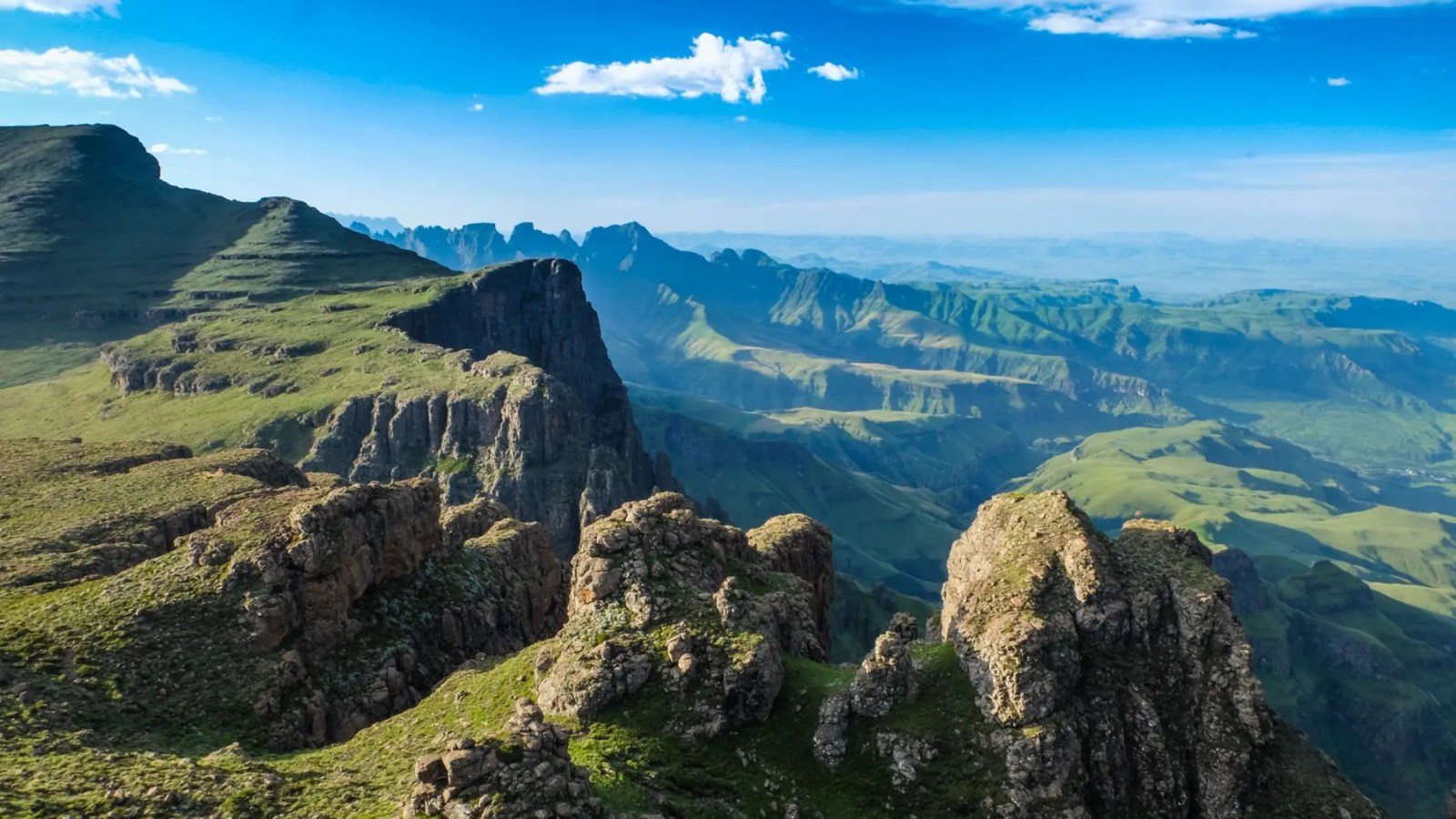 photo of the valley from the mountain plateau in the drakensberg mountains