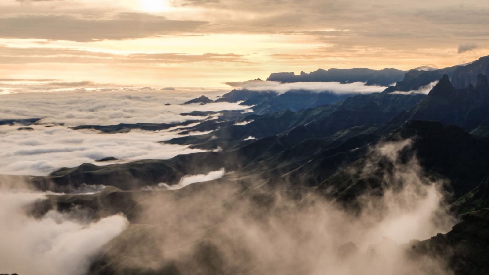 photo from above the clouds showing the sunset in the drakensberg mountains