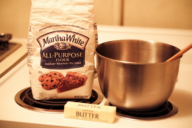 All-purpose flour, butter, metal bowl with spoon on a stove