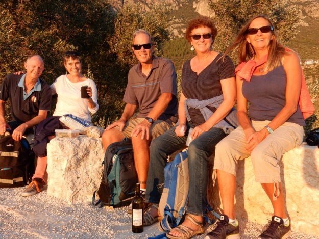 "David and Melinda (""Sassoon""), Michael (""Pakia Mist""), Laura, and Gloria (""Pakia Mist"") sharing sundowners at the top of the ancient Lycian Coliseum, Kaş"