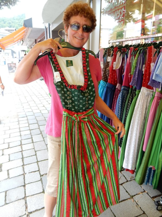 Laura holds up a dirndl in Bad Ischl.  Local women  wore these.  The men wore liederhosen.