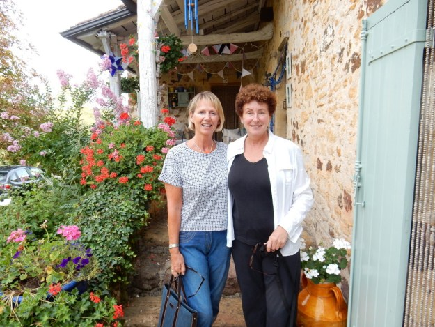 Melinda and Laura in front of Melinda's home in Fongalop