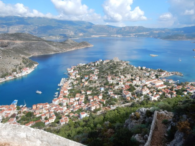 View of Kastellorizo harbor from the top of the cliffs. Sabbatical III can be seen in nearby Mandraki Bay on the left.