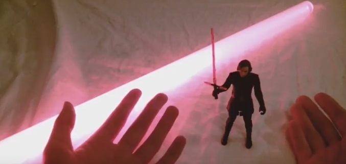 Kylo Ren action figure with red lightsaber blade in the background