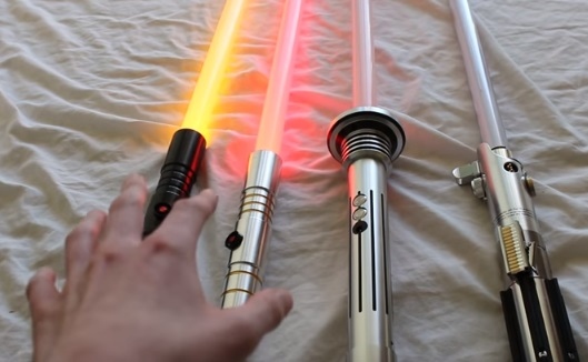 lightsabers from various custom saber companies