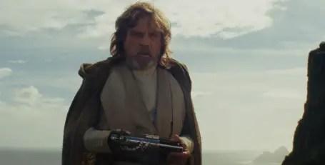 Luke Skywalker holding a lightsaber