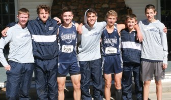 The Bluejay harriers gather for a group photo after finishing in third at the 3A Regional Cross Country meet on Saturday, October 20, in Sabetha. Pictured are (L-R) Charlie Bestwick, Micah Romines, Henry Glynn, Spencer Strahm, Kaden Dillon, Braden Menold and Darrin Funk.