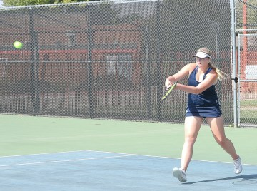 Senior Jessica Payne defends her side of the court and sends the ball back across the net during the 3A Tennis Regional competition on Friday, October 5, in Hesston.