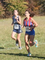 Freshman Jadyn Dorn paces herself during the 3A State Meet on Saturday, October 27, at Rim Rock.