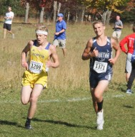 Sophomore Kaden Dillon works to pass this Norton Community runner during the 3A State Meet on Saturday, October 27, at Rim Rock.