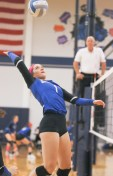 Junior Morgan Schuette goes up for the spike during Sabetha's match-up with Hiawatha on Tuesday, October 16.