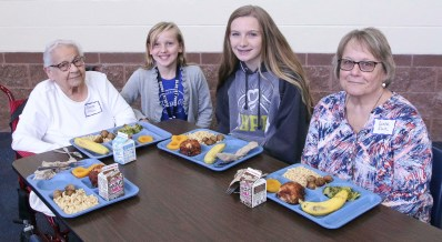 Sabetha Middle School students Kelsey Herrmann and Emily Herrmann enjoy lunch with their grandmothers during the eighth grade Grandparents Day on Thursday, September 27. Pictured are (L-R) Regina Klein, Kelsey Herrmann, Emily Herrmann and Donna Klein. Seventy-two grandparents attended with the eighth grade students.