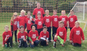 Members of the third- and fourth-grade Red Bulls soccer team are FRONT ROW (L-R) James Sallman, Jackson Jacobs, William Anson, Lincoln Menold, Collin Montgomery and Neveah Hill; BACK ROW (L-R) Lily Pearson, Lola O'Neil, Rachel Enneking, Gage Jacobs, Isaac Schmid, Reed Toedman, Ethan Wendler and Malachi Strahm. Standing behind is Coach Trever Wendler. Not pictured are Anvay Bhatteja, Gideon Meyer, Gracyn Meyer, Emma Wahwasuck, Owen Geyer and Xavier Deters. The team went 1-6 for the season.
