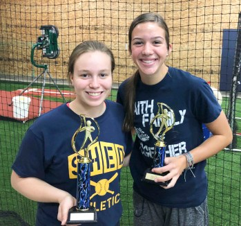 Kinzey Meyer and Hattie Lukert win first and second place, respectively, in the girls' 14U Home Run Derby held as part of ShedFest on Saturday, October 6.