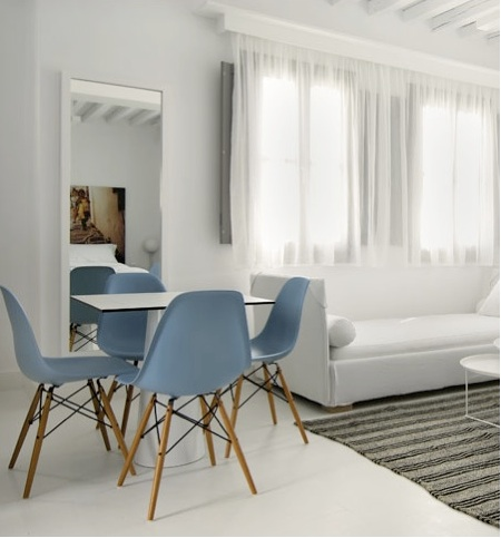 chair design within reach linen parson slipcovers a room at the anemi hotel in greece with an eames inspired molded plastic side chairs light ...