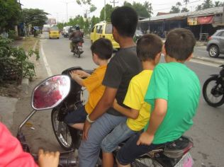 Four boys on a bike