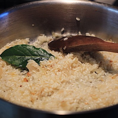 Sautéing Rice And Bay Leaf For Risotto