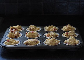 Pan of oatmeal yogurt strawberry rhubarb muffins ready for the oven