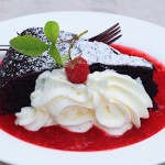 Chocolate Cake with Raspberry Sauce and Whipped Cream