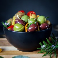 Warm marinated olives is a fragrant recipe with herbs, spices and citrus