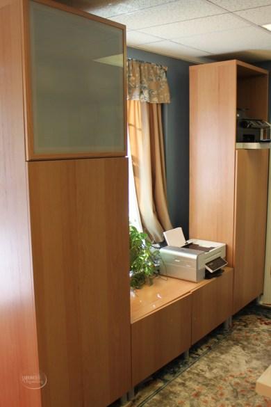 Customized Ikea cabinet around window