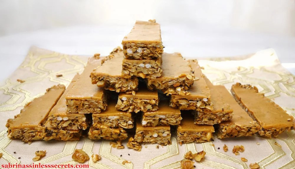 Gluten-Free Triple Peanut Butter Granola Bars arranged in a pyramid with a white background