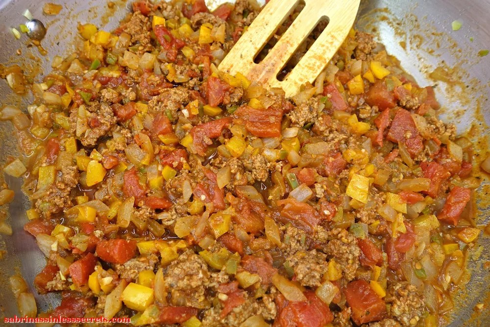 Grass-fed ground beef, tomatoes, onion, bell pepper, jalepeno pepper, and spices cooked in a stainless steel skillet
