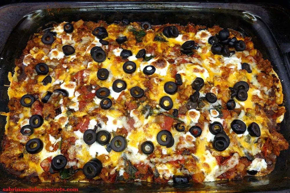 A homemade Gluten-Free Healthy Mexican Casserole right out of the oven in a glass 9x13-inch baking dish