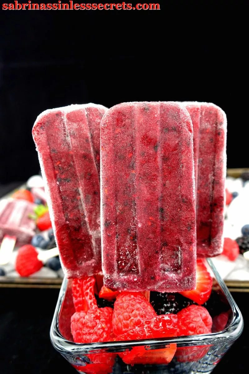 These Paleo Mixed Berry Pomegranate Popsicles taste too good to be sinless! They're sweet and have a hint of sourness, like candy! They're the ultimate summer treat! With only 5 minutes to whip up, you won't mind making them on the regular! These popsicles are gluten-free, vegan, dairy-free, refined sugar-free, and clean-eating!
