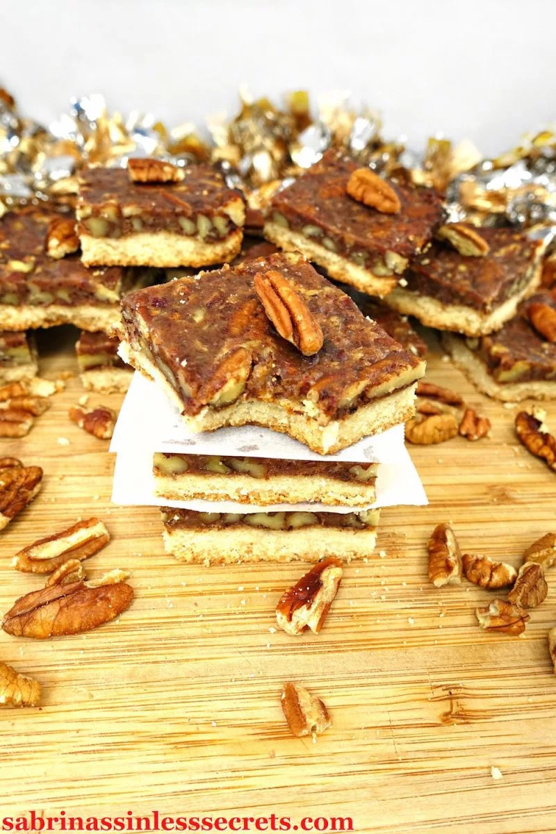 """These Paleo and Vegan Pecan Pie Bars are sweet, sticky, and full of toasted pecan goodness! They're made with a simple date caramel overlaying a shortbread crust! These will """"wow"""" even the pickiest of eaters and leave you craving more, especially when you find out they're completely sinless—made with Paleo, gluten-free, grain-free, vegan, dairy-free, refined sugar-free, and clean-eating ingredients!"""