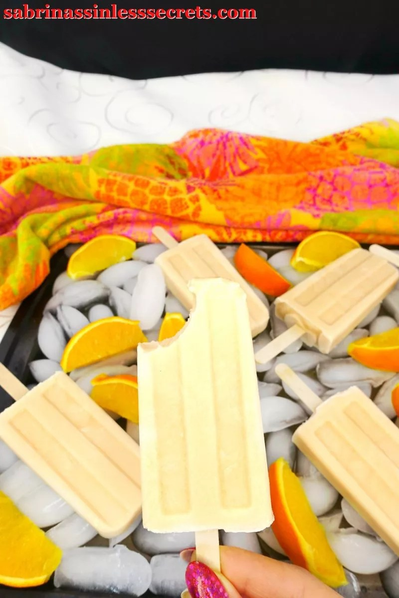 These Paleo and Vegan Orange Creamsicle Popsicles taste like they're fresh out of an ice cream truck, except they're dairy-free, refined sugar-free, gluten-free, vegan, Paleo, and clean-eating! Who would've thought you'd be able to have a guilt-free, sinless, and delicious orange creamsicle popsicle that's also quick and easy to make?
