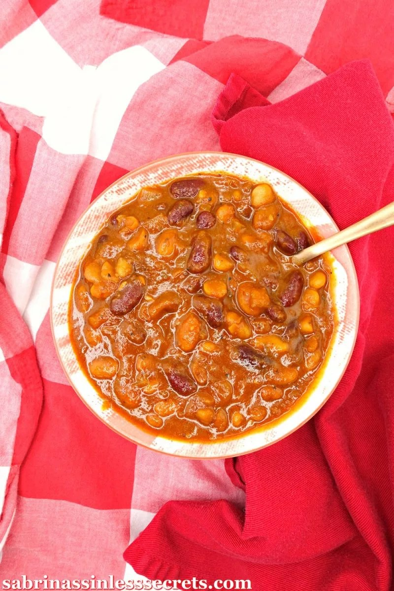These Gluten-Free and Vegan Baked Beans will have you throwing out the store-bought ones! Three types of beans, basking in a thick pool of sweet richness, combine to make one delicious side dish! They go perfectly with your summer BBQ needs and any other time of the year! These flavorful baked beans are egg-free, vegan, dairy-free, refined sugar-free, grain-free, and clean-eating!