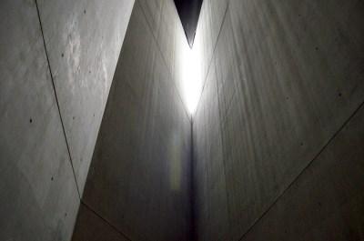 The unlit, unheated, metal room