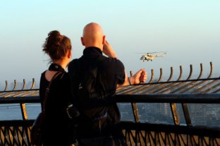 Tourists enjoying the helicopter show and Cairo's view from above of the city's tower.