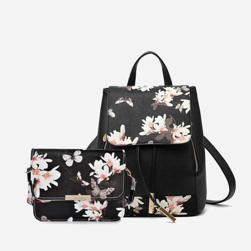 Sac à dos et sac bandoulière en cuir texturé, avec imprimé fleuri et empiècement de couleur or.