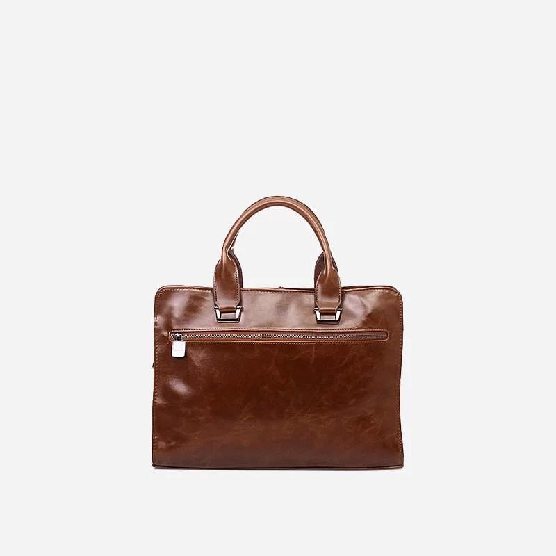 Verso du sac porte-documents et ordinateur pour homme en cuir marron.