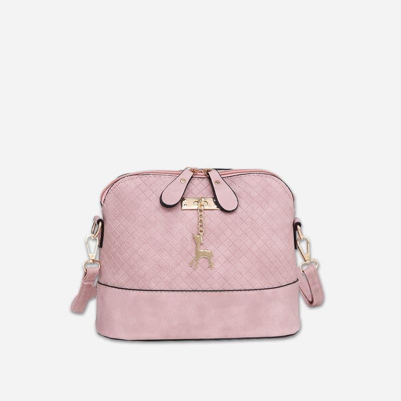 Petit sac à bandoulière en cuir rose pour femme avec des parties dorées. Cerfsbag classic.