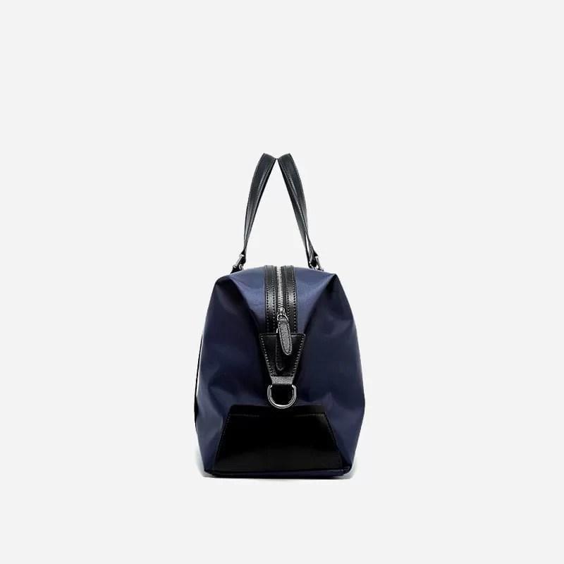 Sac à bandoulière et sacoche bleu pour homme avec plusieurs poches zippées et poches intérieures. Bopaibag Design. Coté.