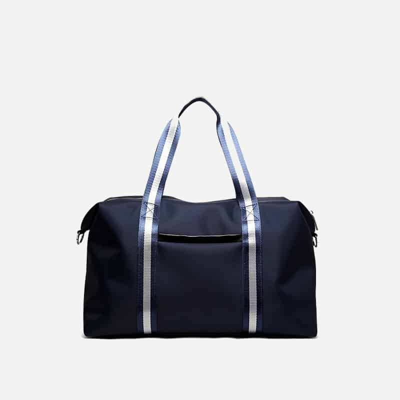 Sac à bandoulière et sacoche bleu pour homme avec plusieurs poches zippées et poches intérieures. Bopaibag Traveler. Zoom.
