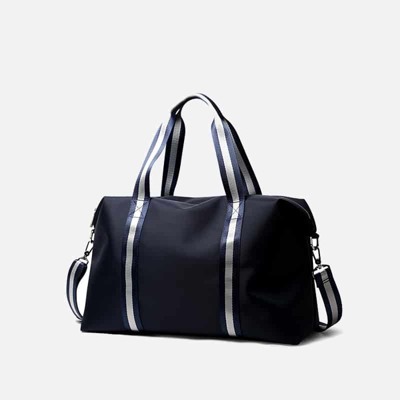 Sac à bandoulière et sacoche bleu pour homme avec plusieurs poches zippées et poches intérieures. Bopaibag Traveler. Zoom 2.