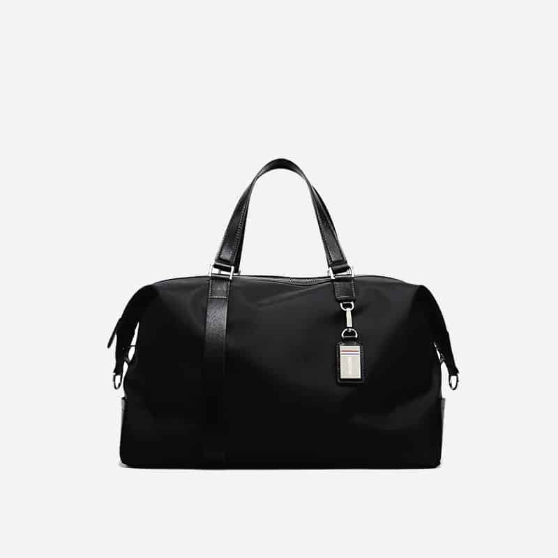 Sac à bandoulière et sacoche noir pour homme avec plusieurs poches zippées et poches intérieures. Bopaibag Design.